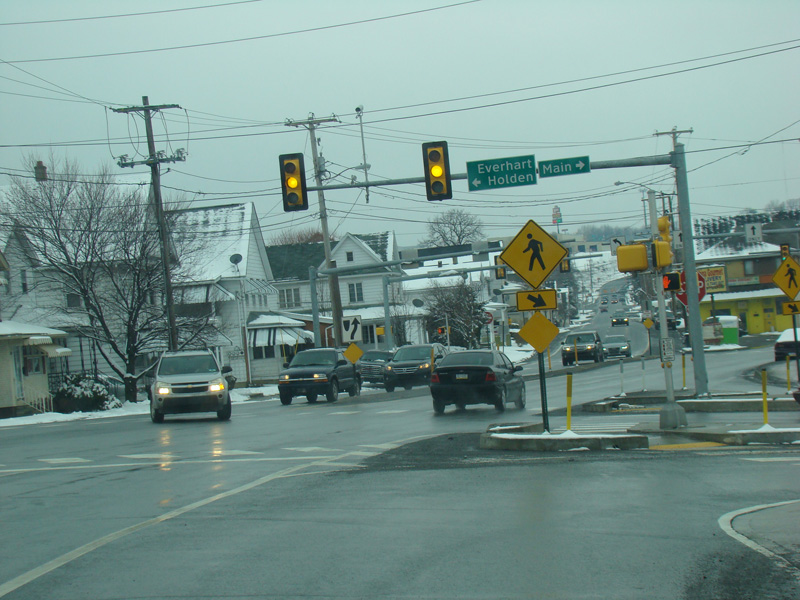 There Is A Traffic Light. Turn Right Onto Main Street For Access To US 11.  Turn Left For Access To Everhart Street And Holden Street.